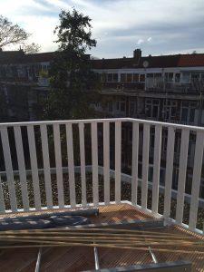 Aluminium lamel hekwerk in kleur RAL 9010 voor dakterras in Amsterdam
